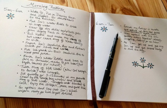 A handwritten outline of the author's morning routine. One page shows the routine between 5am-6am. The next page shows the routine between 6am -7am. It is all written in a leather bound notebook and decorated with colourful hand drawn flowers. This shows the process the author went through to settle on her calming morning routine. All the information contained in the handwritten note is also outlined in the main text of the blog.